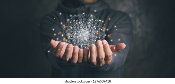 man holding circle global network connection and data exchanges worldwide on work place background, business network communication and technology concept