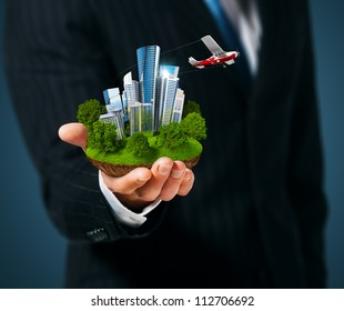 Man holding a city  in hand