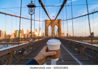 Man holding coffee cup in New York City