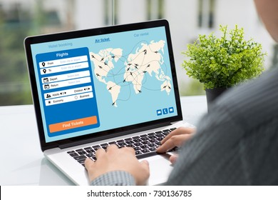 Man holding computer with application search air ticket screen in street cafe