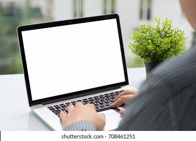 Man holding computer with isolated screen in cafe