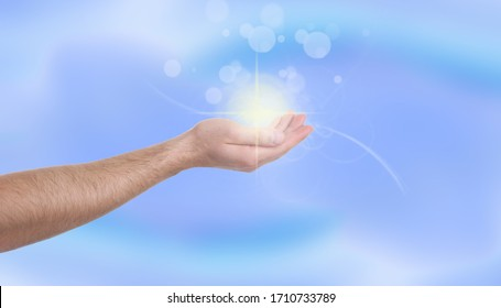 Man holding concentrated healing energy in his hand, closeup