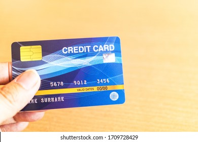 Man holding credit card on laptop. On-line shopping on the internet using a laptop