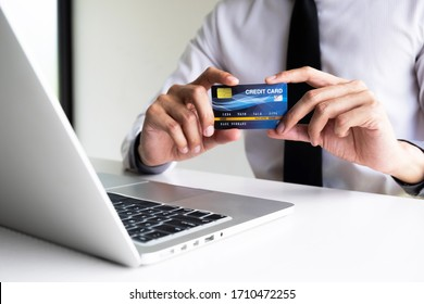 A man holding credit card for shopping online.