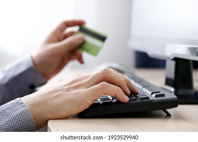 Man holding credit card types on PC keyboard. Concept of online shopping and payment, financial transactions