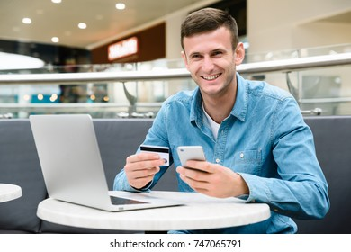 Man holding a credit card and using smart phone for online shopping Online payment