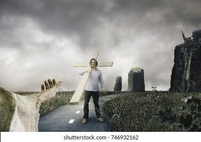 Man Holding Cross Following Jesus