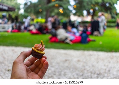 Man holding cupcake during festival