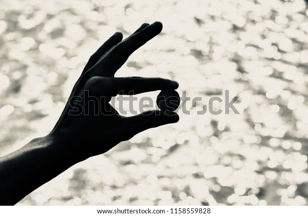 Man holding a currency coin with his fingers isolated unique photo