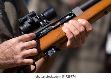 A man holding a dart gun