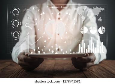 Man holding digital tablet. Financial statistics, business graphs, social network and connection. Future and finance concept