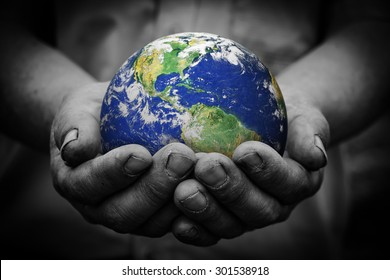 Man holding an earth globe in his hands. Earth image provided by NASA.