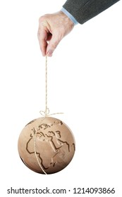 Man holding the Earth hanging on a thread. Isolated over white background