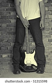 man holding electric guitar, grunge colors
