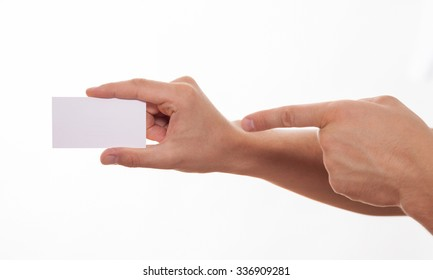 Man holding empty business card and pointing on it, white background