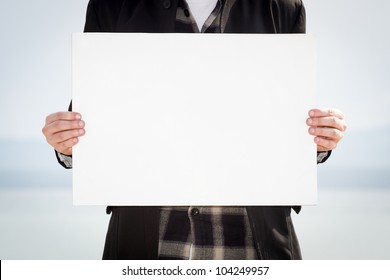 Man holding empty paper in hands