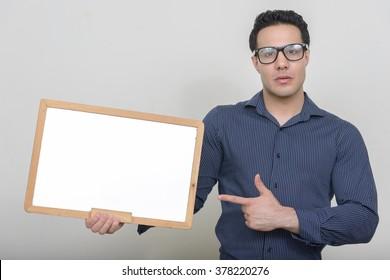 Man holding empty white board