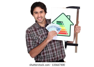 man holding an energy consumption label and a lot of money in cash