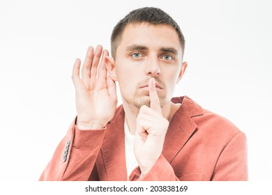Man holding finger near the mouth