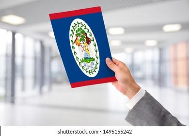 Man Holding Flag of Belize. Belize in Hand.