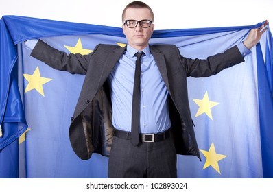 Man holding flag of European Union with both hands.