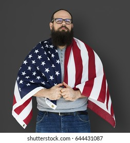 Man holding flag and posing for photoshoot