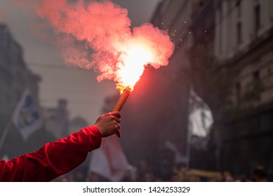 Man holding flaming torch during protest