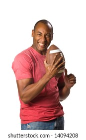 Man holding football with intense grip on ball and a victory smile facial expression. On-White