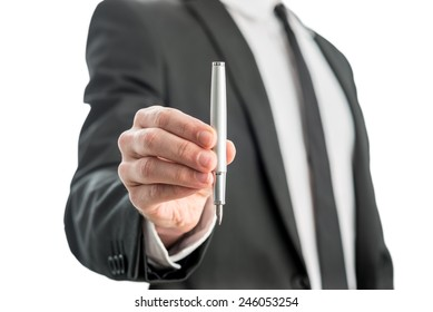 Man holding a fountain pen in his hand with the nib facing down in a communications concept, isolated over white background.