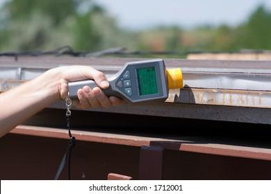 Man holding a Geiger Counter