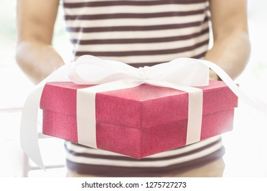 Man holding a gift box for special day