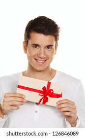 man holding a gift card in his hand. gift certificate.