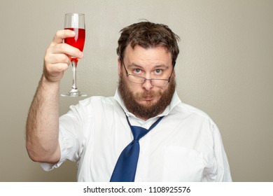 Man holding up a glass giving cheers but he is very drunk