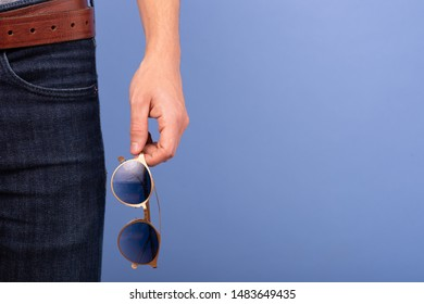 man holding glasses on his hands
