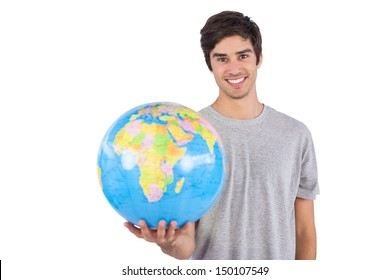 Man holding a globe on a white background