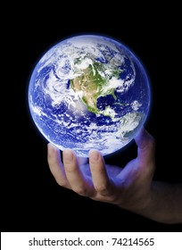 Man holding a glowing earth in his hand. Earth image provided by NASA.