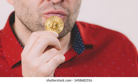 Man holding golden bitcoin coin sign, digital symbol of new virtual currency