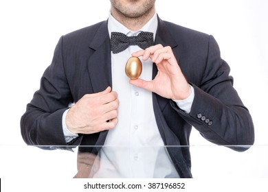 Man holding a golden Easter egg