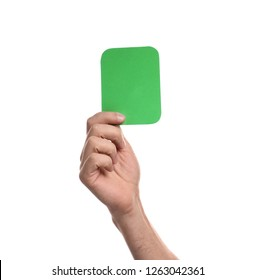 Man holding green card on white background, closeup of hand