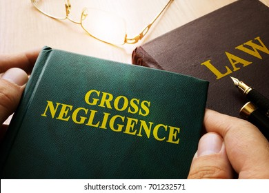 Man holding Gross Negligence book.