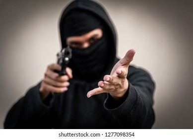 A man holding a gun in hand, the ship ready to shoot the man pointed a gun at us. A man holding a gun was robbed.