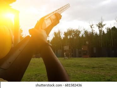 Man holding gun in street