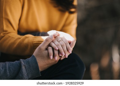 man holding the hand of his beloved woman