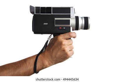 Man holding in hand old vintage video camera