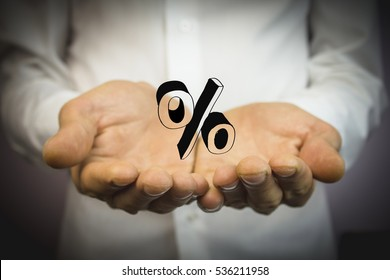 man holding hand on the percent sign