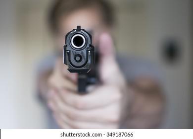 Man holding a handgun in self defense