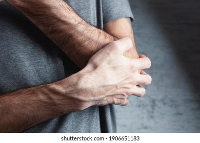 The man is holding hands. Elbow pain