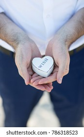 Man holding in hands heart wooden box with love message