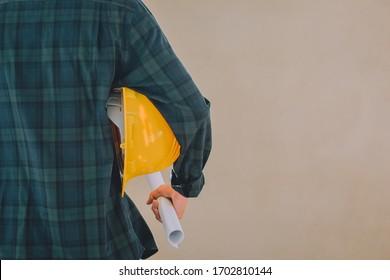 Man holding hard hat blueprint,Supervisor Foreman Manager in construction