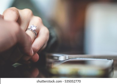 Man holding his girlfriend's hand - Man making a marriage proposal to his girlfriend - Happy engaged couple holding hands